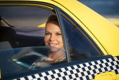 People travelling-business woman in yellow taxi — Stock Photo