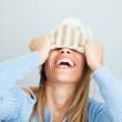 Woman covering face with hat — Stock Photo #9304974