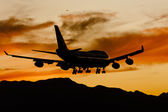 Aircraft Landing At Sunset — Stock Photo