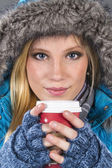 Blonde Winter Model Drinking Beverage — Stock Photo
