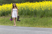 Model Walking Down Road — Stock Photo