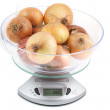 Ripe onion weighing electronic scales — Stock Photo