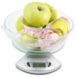 Kitchen scale with apple and tape measure — Stock Photo