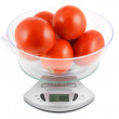 Ripe tomatoes are weighed in the balance — Stock Photo