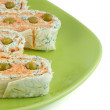 Royalty-Free Stock Photo: Salmon roll and cheese on a green plate
