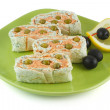 Royalty-Free Stock Photo: Salmon roll and cheese with olives and lemon
