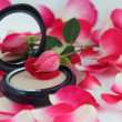 Stock Photo: Compact powder, rose bud and petals