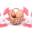 Basket with Easter eggs and two rabbits isolated on white — Stock Photo