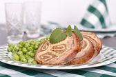 Table setting. Meatloaf, garnished with green peas, mint sprig — Stock Photo