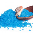 Fragrant blue bath salt and sea shell on a wooden spoon - Stock Photo