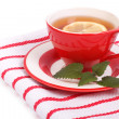 Lemon tea in a beautiful cup and saucer decorated with mint - Stock Photo