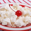 Fresh delicious cottage cheese with cherry in red plate - Stock Photo