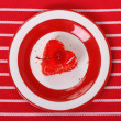 Cake in the form of a red heart top view - Stock Photo