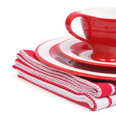 Beautiful red tea cup and saucer on a striped napkin — Stock Photo