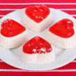 Four cheese cake in the form of heart on a white plate - Stock Photo
