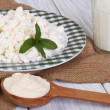 Milk, cottage cheese and sour cream on the table — Stok fotoğraf