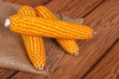 Corn on the cob on a brown wooden table — Stock Photo