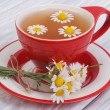 Chamomile tea on a wooden table. Tableware — Stock Photo