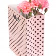 Stock Photo: Pink roses in gift bag isolated on white background