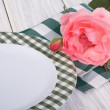 Stock Photo: Table setting. beautiful pink rose and plate on table