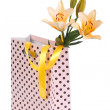 Bouquet of yellow lilies in a gift bag isolated on white — Stock Photo