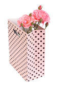 Pink roses in a gift bag isolated on white background — Stock Photo
