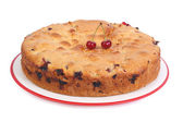 Cherry pie with berries and raisins isolated on white background — Stock Photo