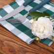 Stock Photo: Cutlery knife and fork and white rose on napkin