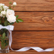 Stock Photo: Beautiful frame of bouquet of white roses and ribbon