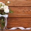 Beautiful frame of the bouquet of white roses and a ribbon — Stock Photo