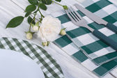 Festive table setting, decorated with a white rose — Stock Photo