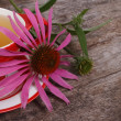 Tea with Echinacea on an old wooden table — Stock Photo