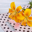 Bouquet of yellow flowers lilies and pink gift bag — Stock Photo