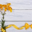 Floral frame from flowers yellow roses and ribbons with bow — Stock Photo #28426721