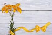 Floral frame from flowers yellow roses and ribbons with bow — Stock Photo