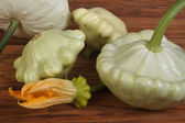 Ripe pattypan squash vegetables on a wooden brown table — Stock Photo