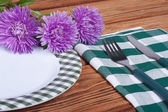 Served table decorated with bouquet of asters — Stock Photo