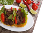 Mexican fast food: tacos stuffed with meat and vegetables — Stock Photo