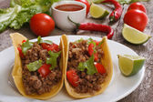 Tacos stuffed with ground beef and chili sauce — Stock Photo