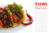 Mexican tacos with chili peppers isolated on white background — Stock Photo