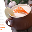 Cream soup shrimp isolated on the wooden table — Stock Photo