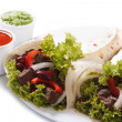 Stock Photo: Two burritos with meat and vegetables and sauce isolated