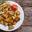 Grilled chicken steak with potatoes and vegetables. top view — Stock Photo #34687275