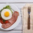 Stock Photo: Breakfast with fried eggs and bacon. top view