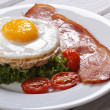 Stock Photo: Rice cakes with eggs, bacon, lettuce and tomato on table