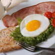 Stock Photo: Breakfast of fried eggs with vegetables, bacon and milk