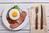 Breakfast with fried eggs and bacon. top view — Stock Photo