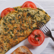 Stock Photo: Scrambled eggs with spinach on table view from above