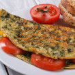 Stock Photo: Omelet with spinach and tomatoes. Healthy and tasty breakfast