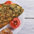 Stock Photo: Omelet with spinach and tomatoes. top view